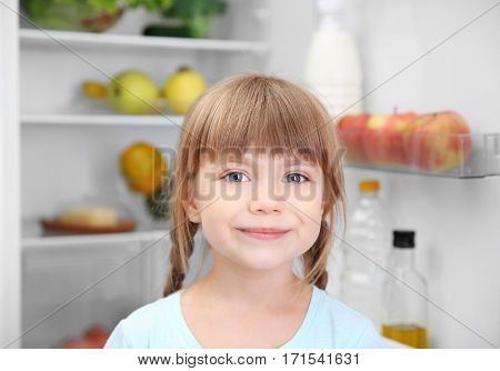 Small girl in kitchen