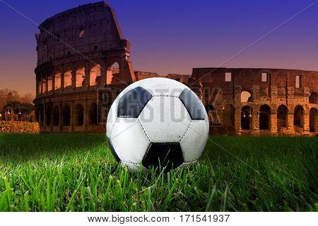 Soccer ball on Colosseum, sunset in Rome