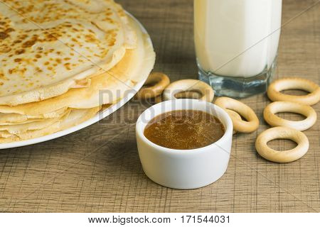 Breakfast milk with pancakes and honey. Tradition