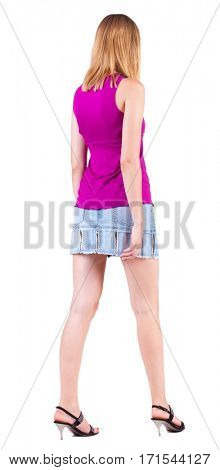 back view of walking blonde woman  in jeans dress. going beautiful girl in motion.  backside view of person. Isolated over white background. Rear view people collection.