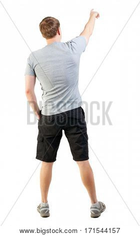 Back view of handsome man in t-shirt and  shorts pointing.   young tourist in summer clothes surprised something. Rear view people collection.  backside view of person.  Isolated over white background