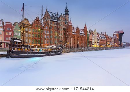 Old town of Gdansk at Motlawa river in snowy winter, Poland