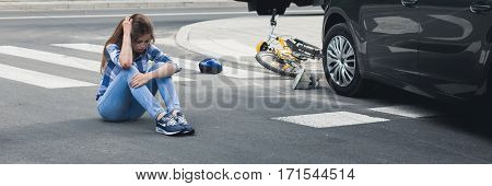 Car Accident Victim Sitting On A Street