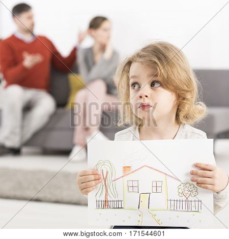 Worried Girl Holding House Picture