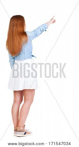 Back view of  pointing woman. beautiful redhead girl. Rear view people collection.  backside view of person.  Isolated over white background.