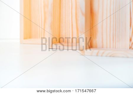 close-up of three accurate natural wooden boxes on white background