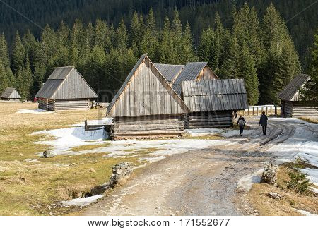 Wooden huts in Chocholowska valley in spring Tatra Mountains Poland