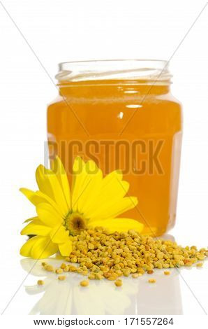 The Jar Of Honey Near A Pile Of Pollen And Flower Isolated On White