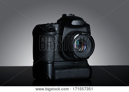Shot Of Dslr Camera In Gray Background