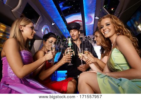 Party fun in limousine with attractive women.