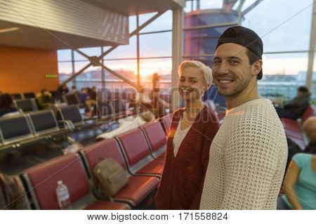 Young Couple In Airport Lounge Waiting Departure Happy Smile Man And Woman Flight