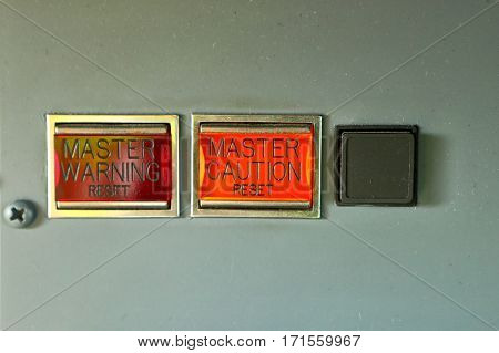 Master warning and caution reset lighted button