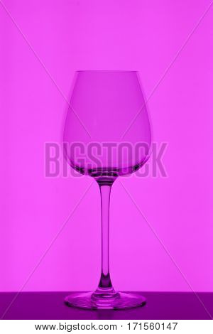 wineglass on purple background, close-up studio shoot