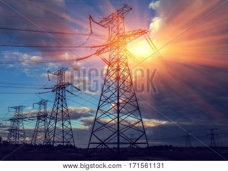 high-voltage power lines. electricity distribution station . high voltage electric transmission tower at sunset.