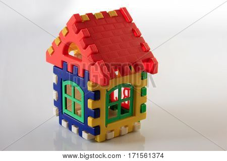 Colorful plastic toy house on white background