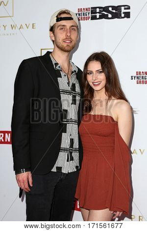 LOS ANGELES - FEB 11:  Bryce Fox, Elizabeth Parker at the Primary Wave 11th Annual Pre-GRAMMY Party at The London on February 11, 2017 in West Hollywood, CA