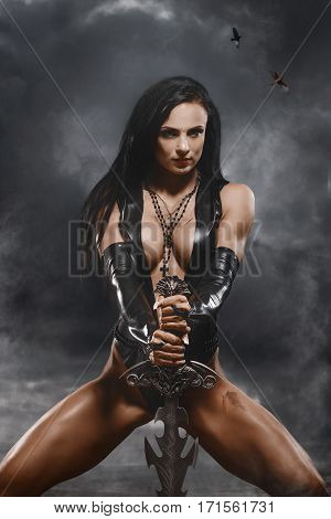Sexy Fantasy Warrior Woman With Big Sword In Mystic Landscape