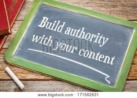 Build authority with your content , blogging tip - text on a slate blackboard with white chalk