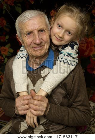 portrait of smiling senior man and the great-granddaughter