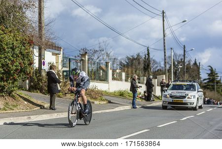 Conflans-Sainte-HonorineFrance-March 62016: The South African cyclist Jay Robert Thomson of Dimension Data Team riding during the prologue stage of Paris-Nice 2016.