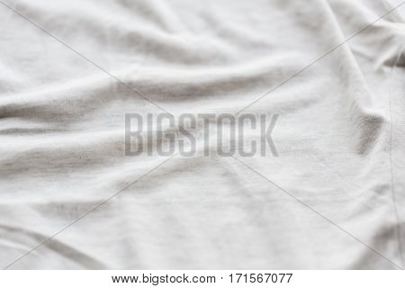 textile and texture concept - close up of cotton fabric background