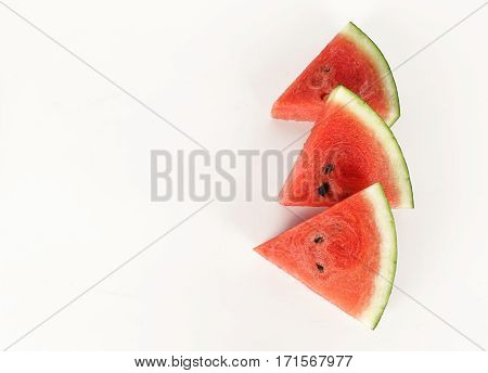 red watermelon whole and slice on plate with mint leaf