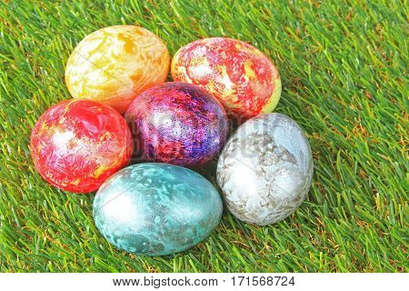 Colorful painted Easter eggs on artificial grass