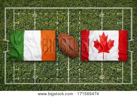 Ireland vs. Canada flags on green rugby field, 3 D illustration