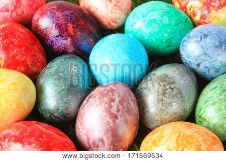 Many colorful Easter eggs red, violet, green, blue, yellow