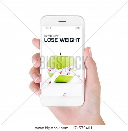 Woman using her smart phone searching lose weight information Measuring tape wrapped on green apple fresh in lose weight and diet concept Isolated on white background.