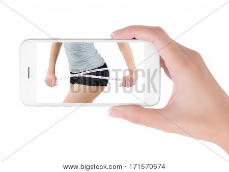 Woman using her smart phone searching lose weight information woman measuring her hip and show perfect body in lose weight and diet concept Isolated on white background.