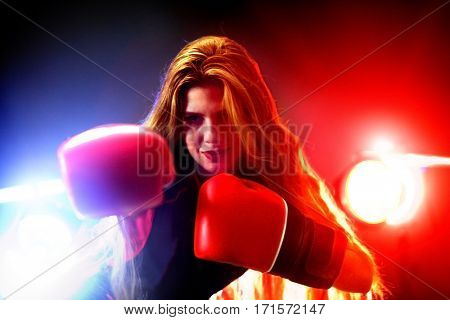 Boxing women fitness exercises in gym. Sport workout on ring .Boxer wearing red gloves to box in ring. Martial arts female.