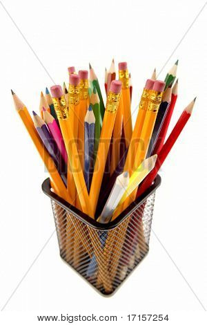Pencils in wire basket on white