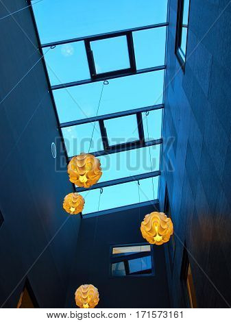 Modern trendy design of transparent glass ceiling in a building