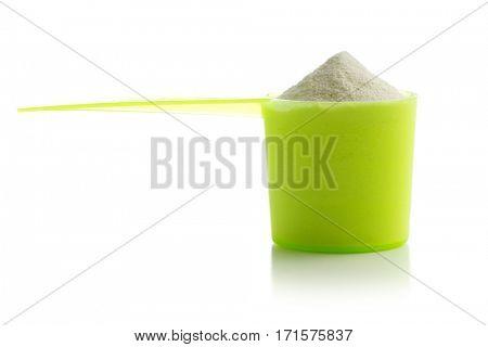 Whey protein powder isolated on white background.