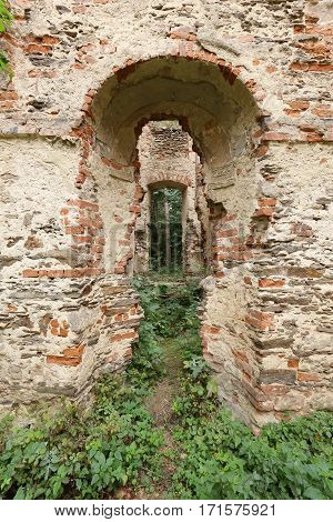 Brick wall window portal of the ruined villa