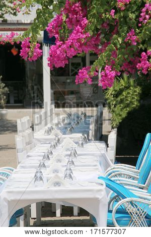 The photo was taken in Turkey. The photograph shows for holiday served with outdoor tables.