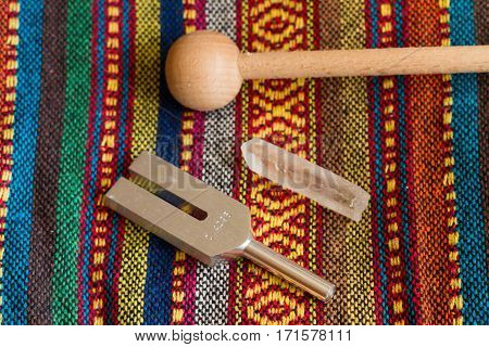 healing tuning fork and crystal stone .