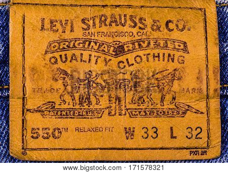 Chisinau Moldova February 10 2017: Close up of the LEVI'S leather label on the blue jeans. Retro style toned image. LEVI'S is a brand name of Levi Strauss and Co founded in 1853