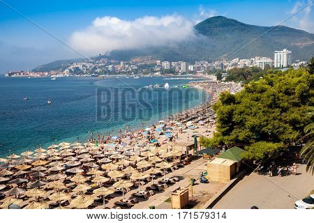 Budva, Montenegro - August, 2016: Beaches with a lot of people and sun umbrellas in Budva, Montenegro