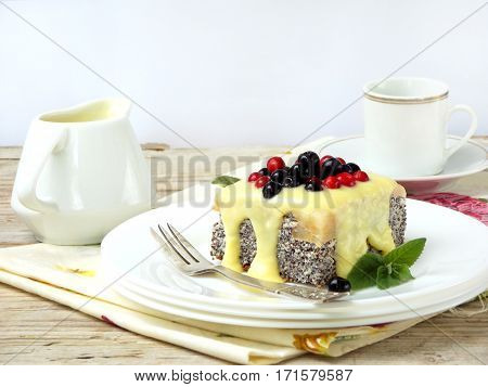 Cottage Cheese And Poppy Cheesecake With Blueberries, Cranberries Poured On Yellow Vanilla Sauce. Ca