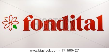 Moscow, Russia - February, 2016: Fondital company logo. Sticker letters on the white wall. Company is specialized in production of boilers, radiators and solar integrated systems