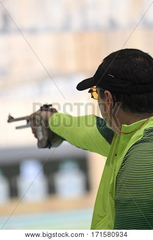 Rio Brazil - august 10 2016: ALMEIDA Julio (BRA) during shooting 50m Pistol Men Shooting at Olympic Games 2016 in Olympic Shooting Centre Deodoro