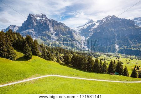 Impressive view of alpine Eiger village. Picturesque scene. Popular tourist attraction. Location place Swiss alps, Grindelwald valley in the Bernese Oberland, Europe. Drone photography. Beauty world.