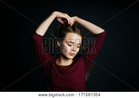 The hand in her hair. Beautiful young girl dancing. Hair flying. Shooting in Studio