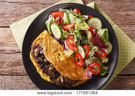 Austrian Cutlet With Mushrooms, Scrambled Eggs And Vegetable Salad. Horizontal Top View