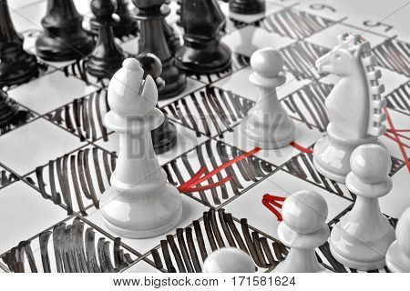 Chess, white's attack. White board with chess figures on it. Plan of battle.
