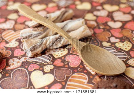 Cookies on dark napkin with image of hearts close up