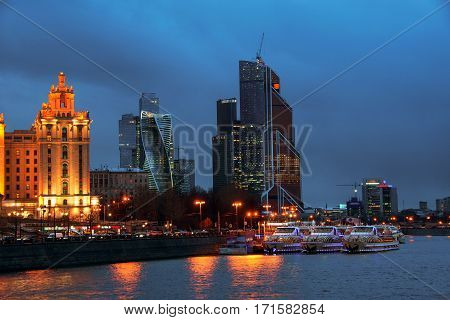 Moscow Russia. Aerial view of hotels with river and skyscrapers in Moscow Russia. Sunset over the Moscow city - modern skyscrapers. Clear blue sky in the capital of Russia