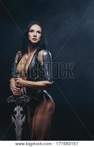 Sexy Fantasy Warrior Woman With Big Sword On Black